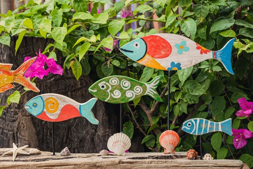 A shoal of colourful fish made of wood