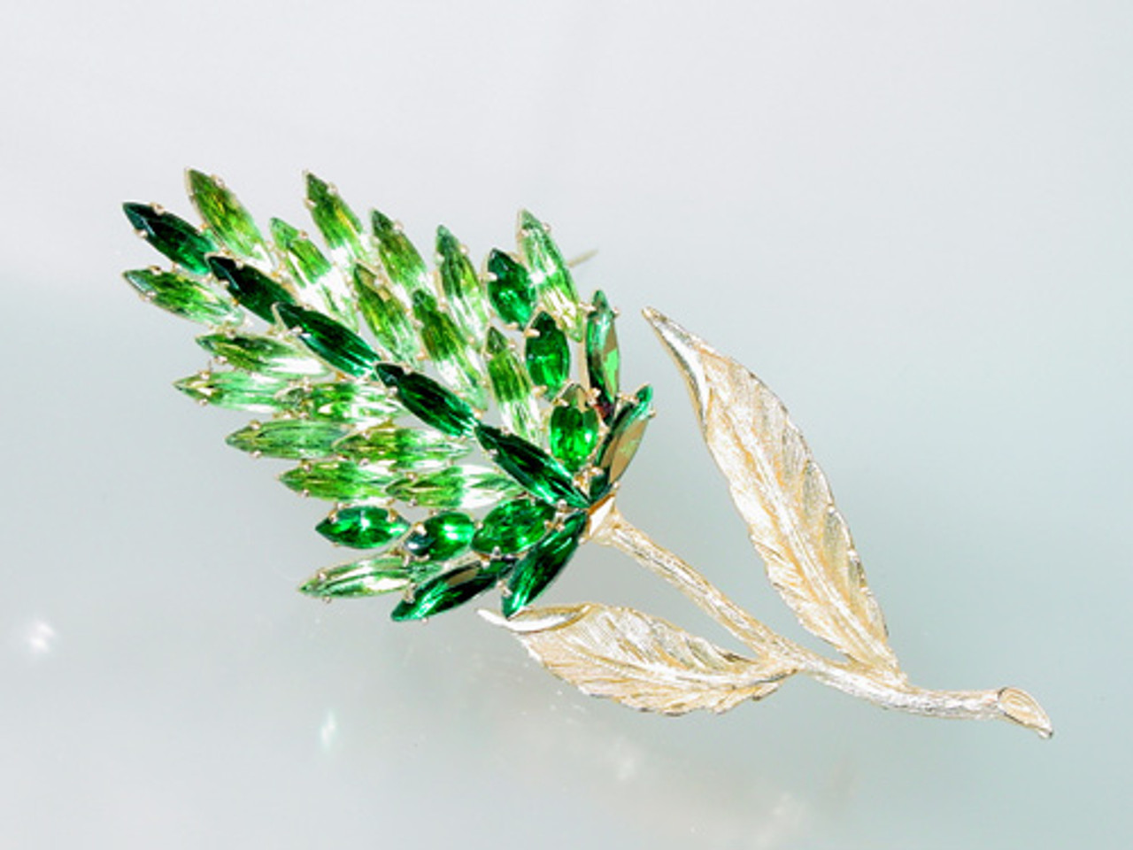 Tall green navettes and marquise floral brooch