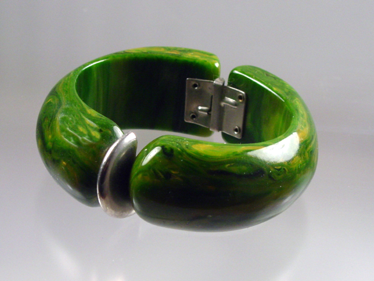 1960's chrome accent hinged spinach Bakelite bangle