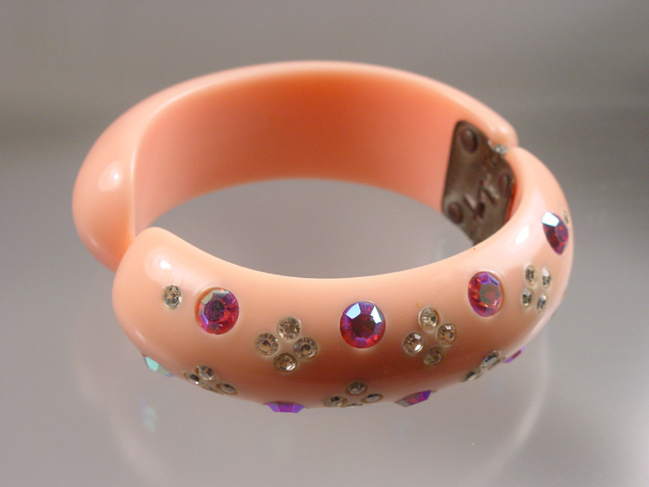 Signed Weiss hinged rhinestone cuff in pink thermoset