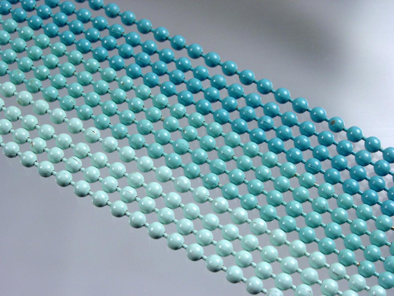 12 strands of enameled metal beads