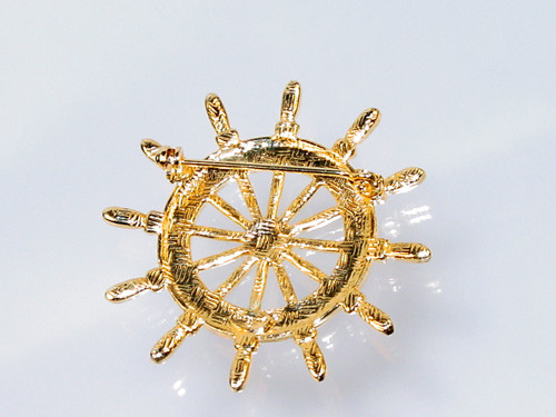 Signed Danecraft on back of nautical brooch