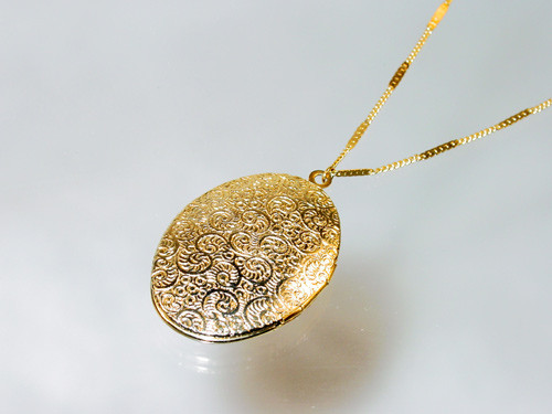 1928 Jewelry Company marking on back