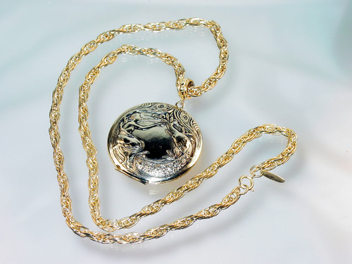 1970's Whiting Davis Locket with woman and peacock