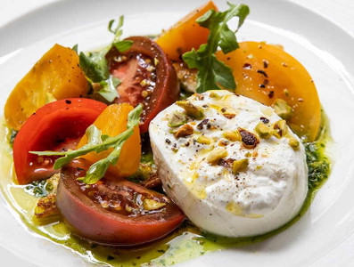 Mozzarella with vine tomatoes and basil