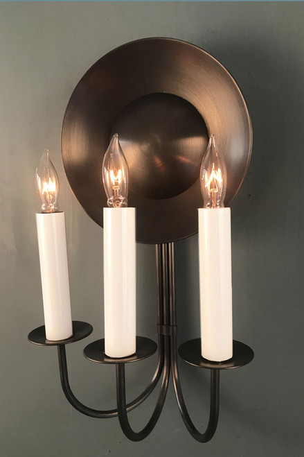 Equinox Sconce here seen in Antiqued Bronze finish