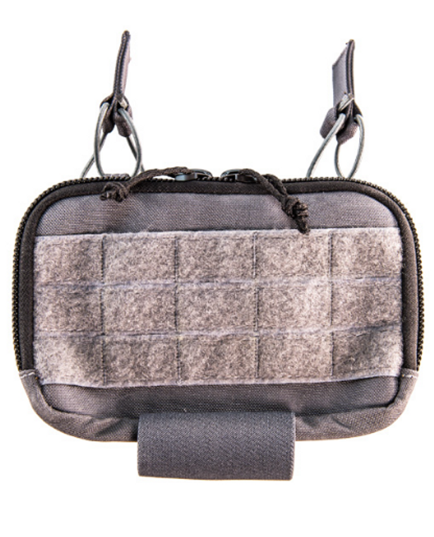 This horizontal admin pouch is a new take on our old favorite, the Mini Modular Admin Pouch, and is constructed from heavy-duty nylon laminate. The two rear slots with bungee retention tabs are perfect for two .308 magazines or smaller.