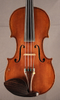Antique French fractional sized violin, close-up.