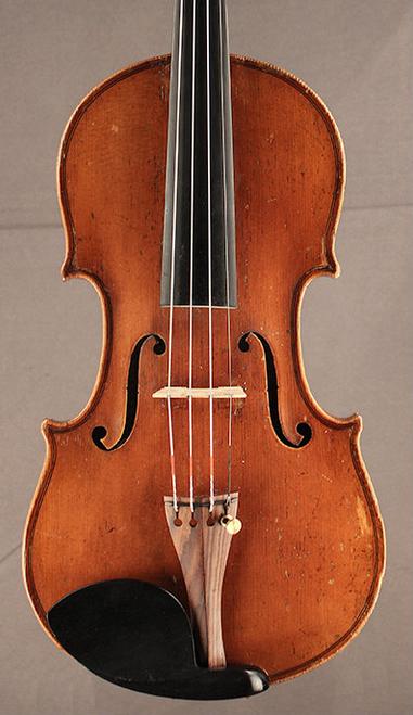 Antique German fractional sized violin, close up.