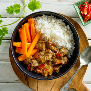Beef Rendang With Rice And Carrot Sticks High Angle