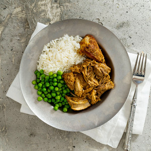 Chipotle Pulled Pork With Rice And Green Peas High Angle