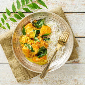 Goan Fish Curry With Spinach And Rice High Angle