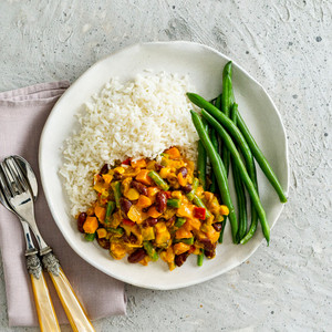 Veggie And Bean Curry With Rice And Green Beans High Angle