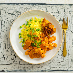 Butter Chicken With Basmati Turmeric Rice And Green Peas High Angle