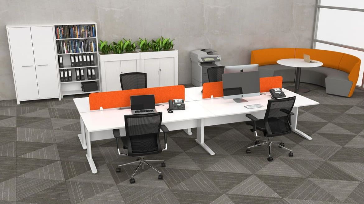 Minimalistic Open Plan Office with one 4 Person Workstations and Rounge Lounge Seating