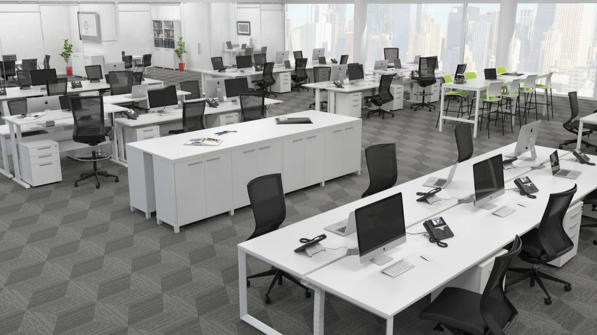 Modern Open Plan Office with Height Adjustable Workstations, Storage Solutions and Black Office Chairs