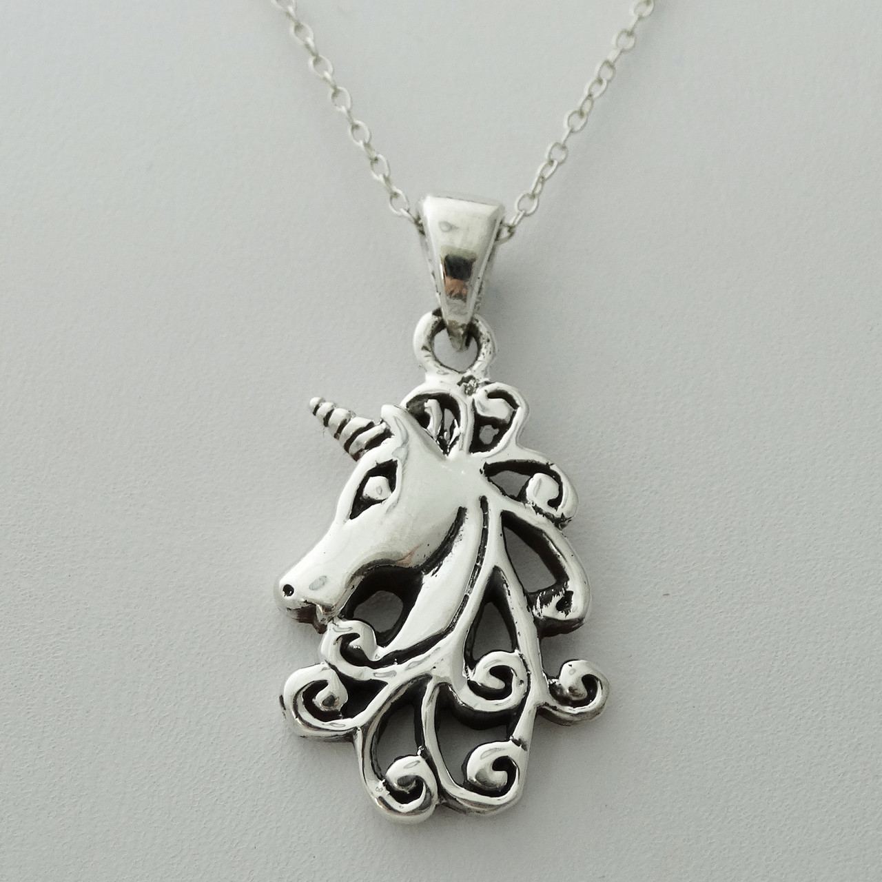 Sterling silver unicorn pendant charm on a sp necklace chain