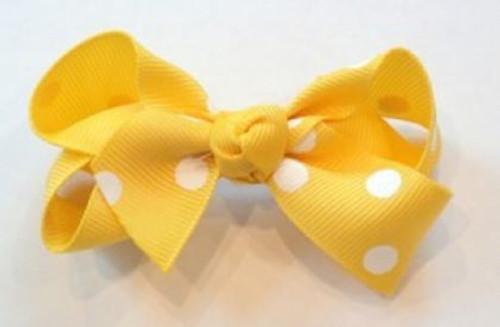 Children's yellow polka dot hair bow