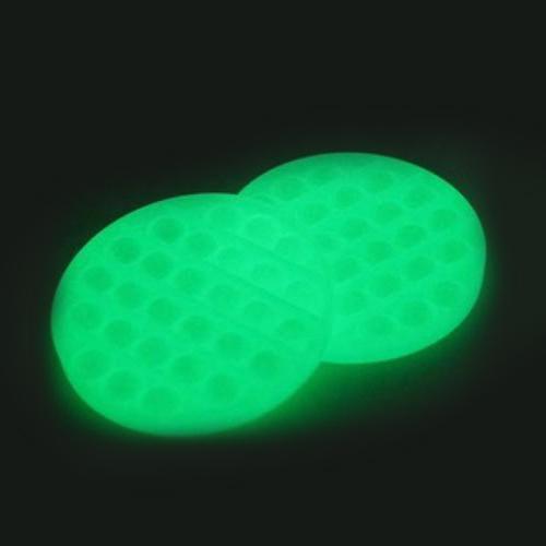 2x Glow-in-the-Dark Round Pop Fidgety shown glowing on black background.
