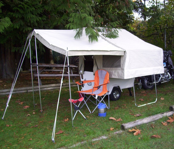 The awning kit gives you a nice spot to create a covered sitting area outside the camper.