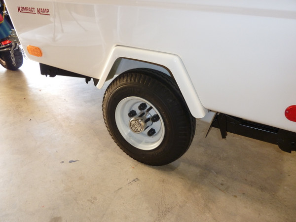"The Mini Mate has two fender options. One is a combined light bar with fender flares. This camper is equipped with the ""fenders only"" option."