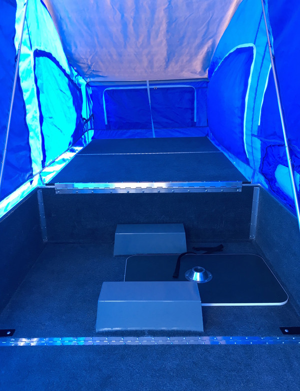 "Camper interior is very clean and the tent still has some ""new tent smell"""