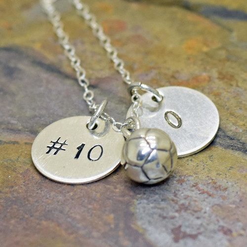 Personalized hand stamped sports necklace with initial and number.  Available with soccer, volleyball, or softball/baseball.