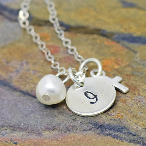 Personalized sterling silver necklace for celebration of religious event.