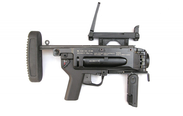 """The HK GLM (Grenade Launcher Module) is a 40x46mm system that can be used with either lethal or less-lethal munitions for Military or Law Enforcement use. The HK GLM is a light weight stand-alone or host weapon mounted 40x46mm single shot grenade launcher that is side breach opening/ loading, utilizing a double-action trigger with ambidextrous safety and controls. The system incorporates a collapsing/extendable and removable stock as well as other accessories. It is capable of fifiring multiple use munitions/projectiles to include High Explosive """"HE"""" rounds to an effective range of 350M, illumination rounds for signaling and visibility, Smoke for screening and obscuring, CS, and various less lethal munitions for crowd and riot control at closer ranges. The GLM can be used in a Stand-Alone Mode (SAM) or it can be host mounted to another riflfle system via optional mounting solutions. The common mounting solutions are for the HK416, HK417, M16A2, and M4. Background: In the 1970s Heckler & Koch """"HK"""" developed and produced the 40x46mm Steel stand-alone HK69 grenade launcher which was similar in performance to the US Military M79 grenade launcher at the time. HK made updates to our existing grenade launchers through internal product improvement efforts which became the HK Grenade Launcher Module (GLM) 40x46mm based on our previous HK 40x46mm systems. The HK GLM was offered to the US Army in 2005 and tested with limited production in 2006 as the XM320. After successful testing the system was approved and type-classifified and procured as the M320/M320A1 (for use on the M16A2 or M4 as well as a stand-alone system) by the US Army in 2008. HK has provided over 40,000 HK GLM type systems to the USA for Military or Law Enforcement use. HK weapon systems are manufactured with an ISO-9001 quality and test process. HK weapons are additionally tested to the NATO AC/225 requirements."""