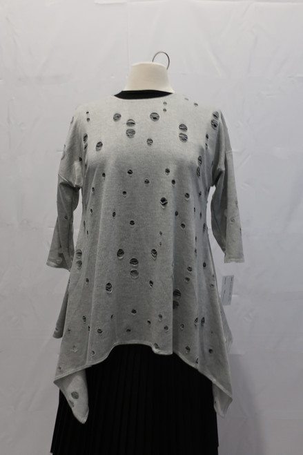 Cool top with with distressed balls and uneven hem Available  in black and grey