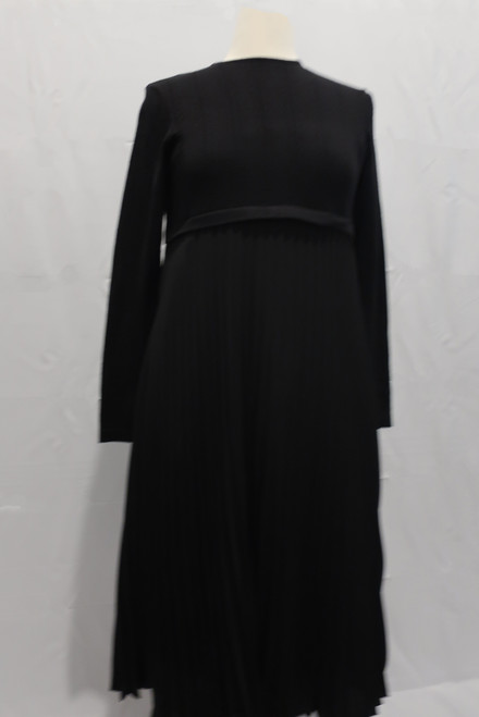 Better black dress with a fine knit top and accordian pleated chiffon bottom