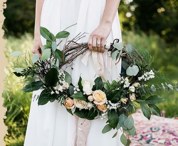 Bride holding floral arrangement