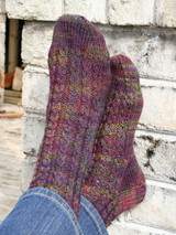 cabled sock knitting pattern using sport weight yarn