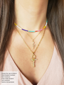 Woman wearing Rainbow Bead Necklace Choker, Dainty Gold Chain Necklace with CZ Pave Snake Necklace Pendant, Dainty Gold Paperclip Necklace Chain with Rounded Textured Snake Cross Necklace Pendant | Mojo Supply Co