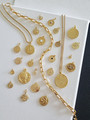 24 Gold Coin Necklace Pendants in a Collection of with Gold Necklace Chains and Various Sizes, Shapes, Colors, Metals, and Styles. Dainty Round Gold Lotus Flower Pendant. Round Sun Moon Gold Pendant. Round Gold White Howlite Stone Pendant. Round Gold Celestial Pendant with Blue Star Stone. Evil Eye Matte Gold Stamped Necklace Pendant. Round Gold Textured Coin Pendant with White Opal Stone Center. Matte Gold Coin with Sun Stamped Detail. Large Round Double Sided Creek Coin Stamped Ancient Greek Goddess. Large Gold Coin Etched Texture Oval Shape. Gold Coin Carved Snake Detail with CZ Diamond Stone and Gold Ball Detail Edging. Tiny Dainty Gold Round Coin with Blue CZ Stone Center. Tiny Dainty Celestial CZ Star Design Necklace Pendant. Large Gold Coin Evil Eye Pendant with Twisted Rope Detailed Edging and CZ Pave Stone Inlay. Large Matte Gold Greek Goddess Coin Necklace Pendant. Smaller Round Shiny Gold Greek Warrior Necklace Pendant. Celestial Gold Sun with Carved Face Necklace Pendant. Round Greek Gold Coin Pendant. Round Celestial Gold Moon and Stars CZ Stones Pendant. Swivel Hanging Gold Coin Ancient Greek Pattern Pendant. Celestial Evil Eye Gold Coin Pendant.  Dainty Gold Round Medallion with White Opal Stone Center   Mojo Supply Co