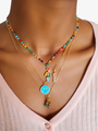 Colorful Gold Beaded necklace layered with dainty necklaces and colorful pendants