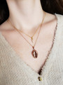 Woman Wearing Two Layers Of Kathleen Necklaces Accentuated With Tiny Elaina Triangle Charm And Huge Cindy Shell Necklace Pendant | Mojo Supply Co