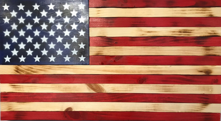 Shown Inside hung on wall: wooden American flag, US flag made of wood, painted stars on field of blue