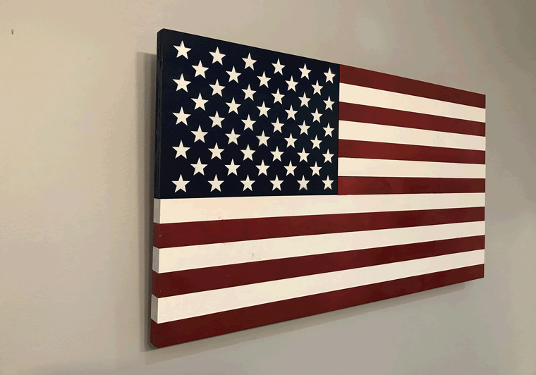 Wooden American flag from the Americana collection. Painted American flag on solid wood. 37 inch flag hung on wall; side view