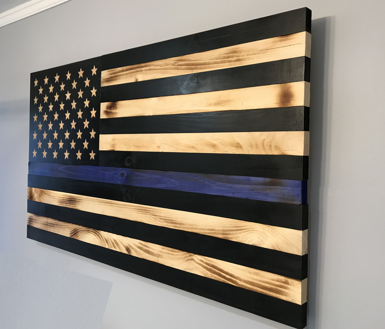 Shown Inside at side angle: thin blue line wood flag 47 x 26 inches, police flag, blue line american flag, us flag with blue line wooden