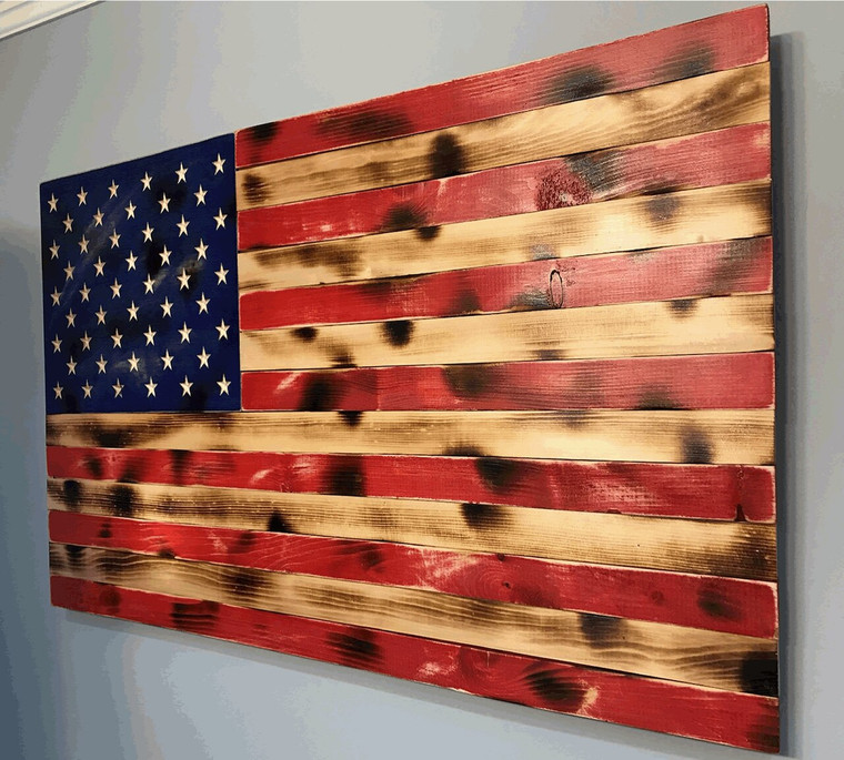 Rustic wood American flag, 68 x 35.5 inches with carved stars. Distressed, solid wood, handmade large wooden flag.