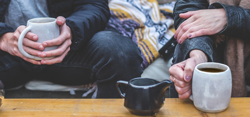 Two people with coffees