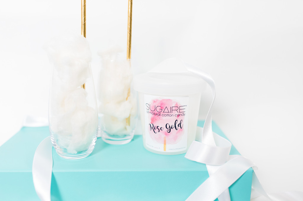 Two crystal stemless champagne flutes with our Rose Gold All-Natural Cotton Candy.