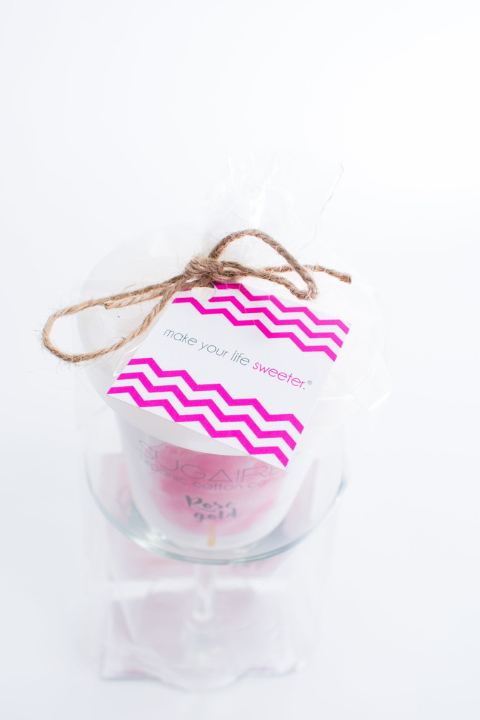 The Sugaire Organic Cotton Candy Martini Infusion Kit includes:  - 1 Martini Glass - 1 Pint of Rose Gold Sugaire Organic Cotton Candy - 1 Instructional card Wrapped in a cellophane bag and tied with a piece of raphia.   Organic Cotton Candy | Organic Flavoring | Dye-Free | Natural, Plant-Based Colors | Vegan & Kosher | Gluten-Free