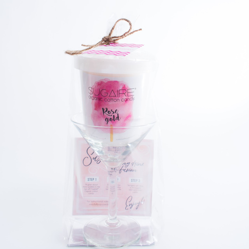 The Sugaire Organic Cotton Candy Martini Infusion Kit includes:  - 1 Martini Glass - 1 Pint of Rose Gold Sugaire Organic Cotton Candy - 1 Instructional card Wrapped in a cellophane bag and tied with a piece of raphia.   Organic Cotton Candy   Organic Flavoring   Dye-Free   Natural, Plant-Based Colors   Vegan & Kosher   Gluten-Free