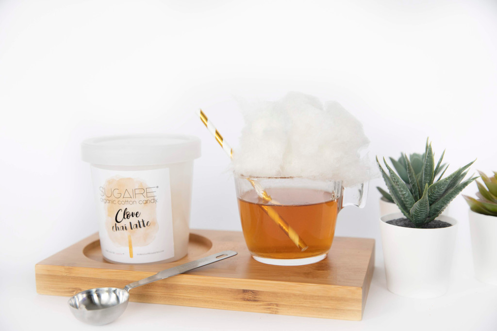 """Want to have a tea party with you friend - VIRTUALLY? Make Your Life Sweeter® has created the """"HOT TEA COTTON CANDY INFUSION"""" gift box to make your quarantine sweeter! This is the perfect gift to let your friends and family - for a sweet virtual afternoon tea time.  The box includes 1 Sugaire Organic Cotton Candy Pint in our Clove Spiced Latte Flavor, 1 Tea Cup, 1 Paper Straw, and  1 Tea Bag.  #cottoncandytea #cabinfever #quarantine #coronavirus #coronavirusgift #getwellsoongift #hotteainfusion"""