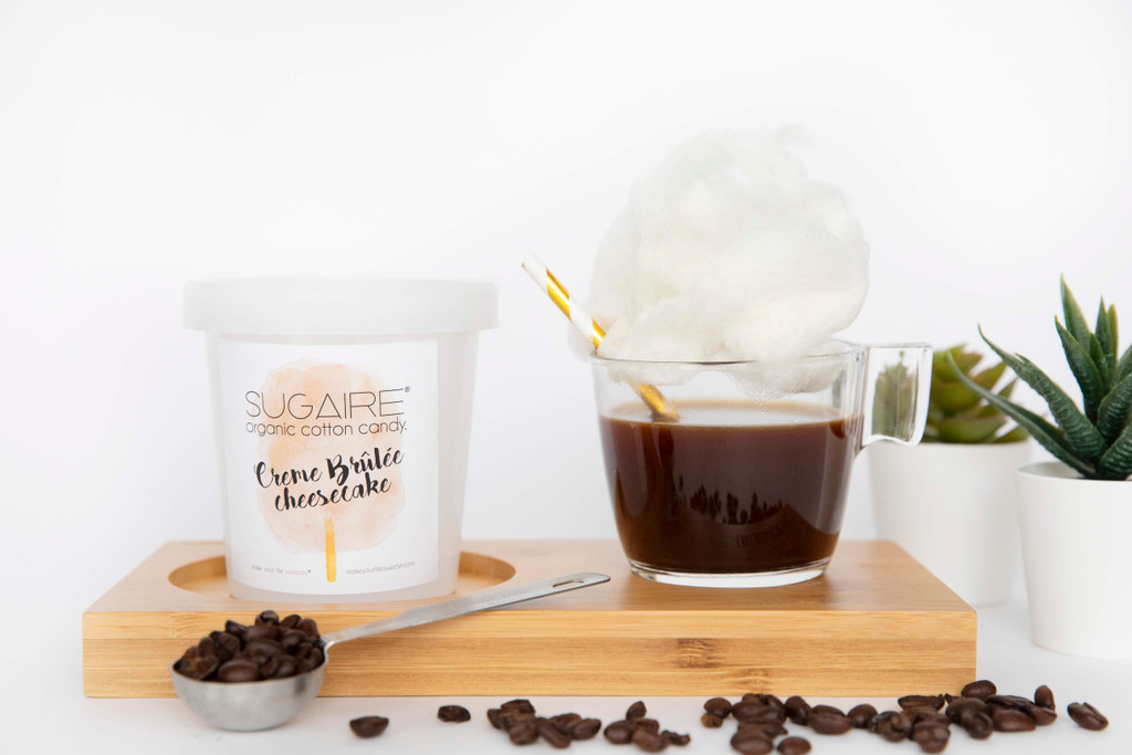 """Want to have a coffee date with you friend - VIRTUALLY? Make Your Life Sweeter® has created the """"HOT COFFEE COTTON CANDY INFUSION"""" gift box to make your quarantine sweeter! This is the perfect gift to let your friends and family - for a sweet virtual afternoon coffee date.  The box includes 1 Sugaire Organic Cotton Candy Pint in our Creme Brulee Cheesecake Flavor, 1 Glass Coffee Cup, 1 Paper Straw, and  1 bag of coffee.  #cottoncandycoffee #cottoncandylatte #cabinfever #quarantine #coronavirus #coronavirusgift #getwellsoongift #hotcoffeeinfusion"""