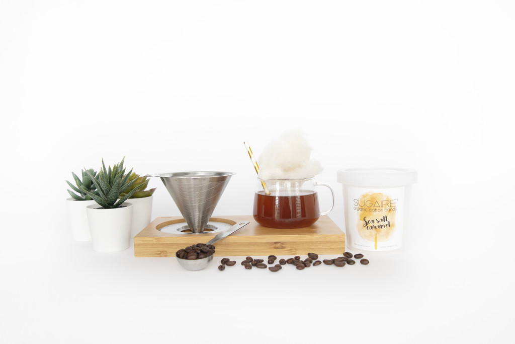 """Want to have a coffee date with you friend - VIRTUALLY? Make Your Life Sweeter® has created the """"HOT COFFEE COTTON CANDY INFUSION"""" gift box to make your quarantine sweeter! This is the perfect gift to let your friends and family - for a sweet virtual afternoon coffee date. The box includes- 1 stainless steel dripper, 1 8oz borosilicate glass cup, 1 coffee spoon, 1 bamboo stand,1 Sugaire Organic Cotton Candy Pint in our Creme Brulee Cheesecake Flavor, 1 Paper Straw, and 1 bag of coffee.  #cottoncandycoffee #cottoncandylatte #cabinfever #quarantine #coronavirus #coronavirusgift #getwellsoongift #hotcoffeeinfusion"""