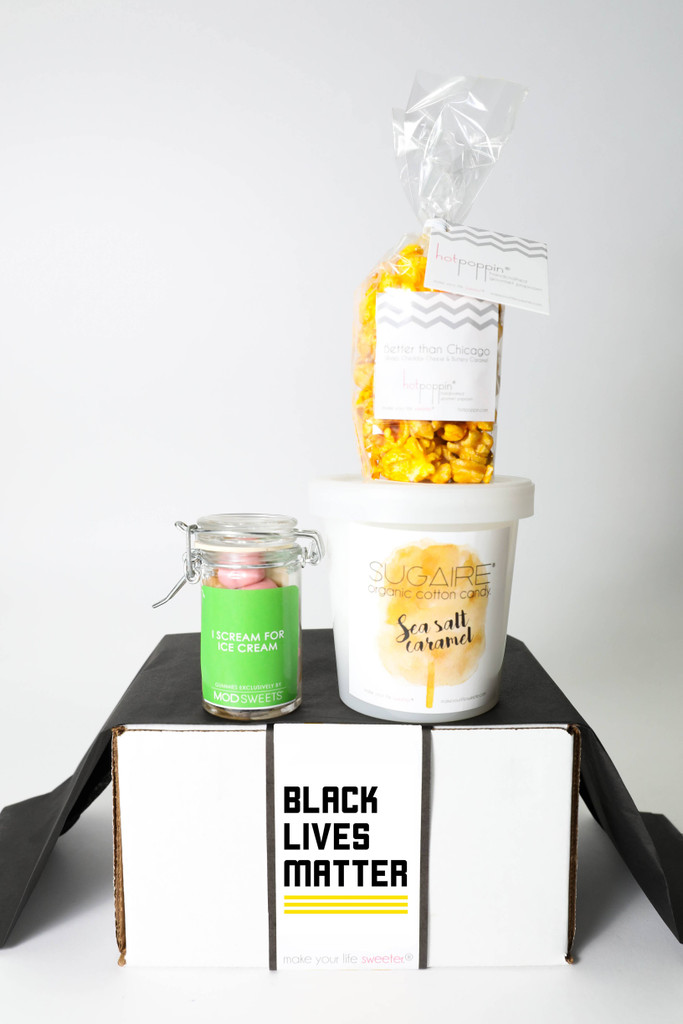 THIS BLACK LIVES MATTER BOX INCLUDES:   1 Sugaire Organic Cotton Candy - 16oz pint - SEA SALT CARAMEL + 1 HOTPOPPIN BAG OF BETTER THAN CHICAGO POPCORN + 1 MINI MASON WITH GUMMIES