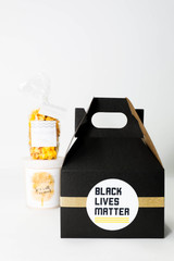BLACK LIVES MATTER GIFT BOX  6x4x4 Gable Box 1 Sugaire Organic Cotton Candy - 16oz pint - SEA SALT CARAMEL 1 Hotpoppin Gourmet Popcorn - 1 cup bag - BETTER THAN CHICAGO - INDULGENT CARAMEL & SHARP CHEDDAR